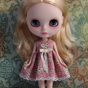 blythe doll wearing a romantic floral dress with white daisies